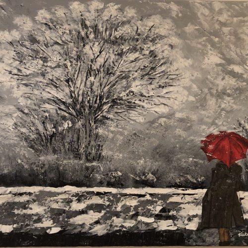 Woman walking in the snow toile réalisé au couteau avec de l'acrylique