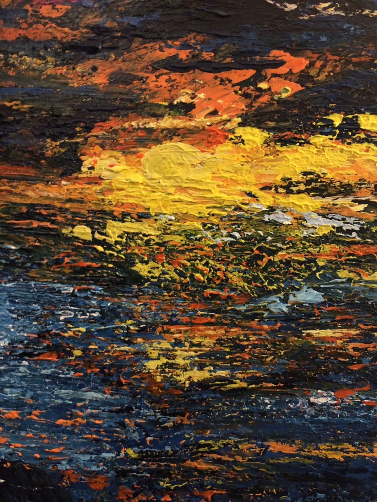 Galopant dans la vague au coucher de soleil
